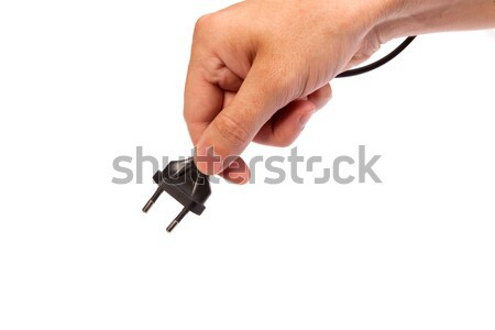 Man is holding a black outlet in the hand Stock photo © bloodua