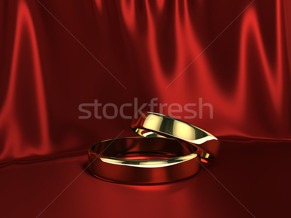 Two gold rings on red silk Stock photo © blotty