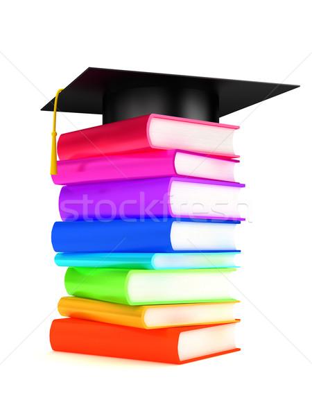 Stock photo: Graduation cap on books