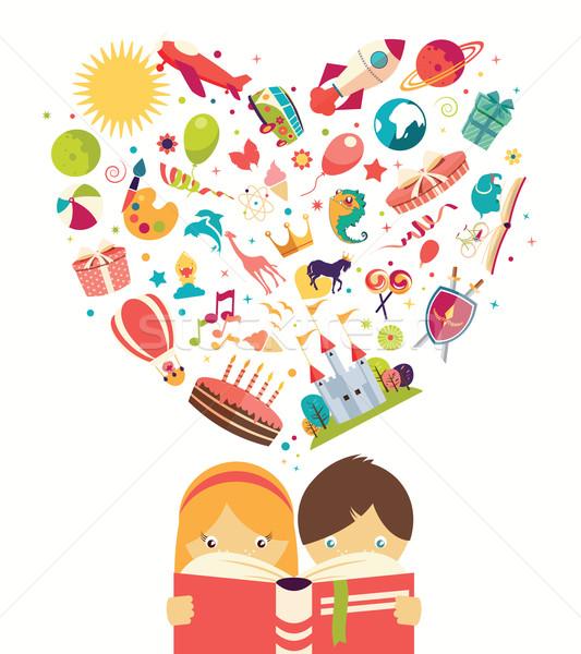 Imagination garçon fille lecture livre objets Photo stock © BlueLela