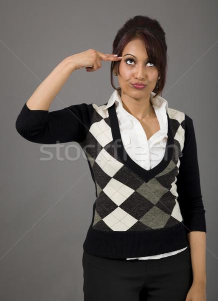 Indiai üzletasszony mutat ujj fej felnőtt Stock fotó © bmonteny