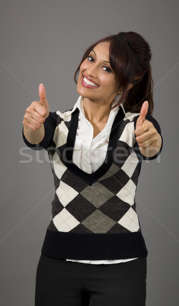 Indian businesswoman showing thumbs up from both hands isolated on colored background Stock photo © bmonteny