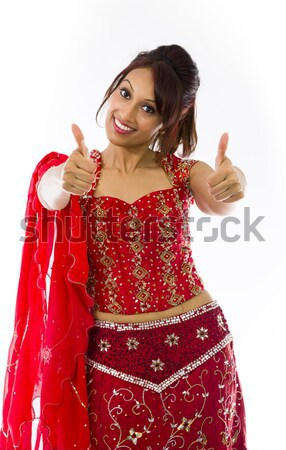 Smiling young Indian woman showing thumb up sign with both hands Stock photo © bmonteny
