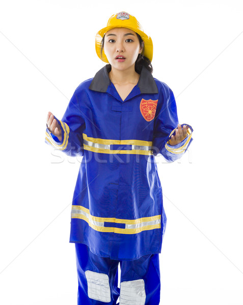 Stock photo: Lady firefighter looking shocked
