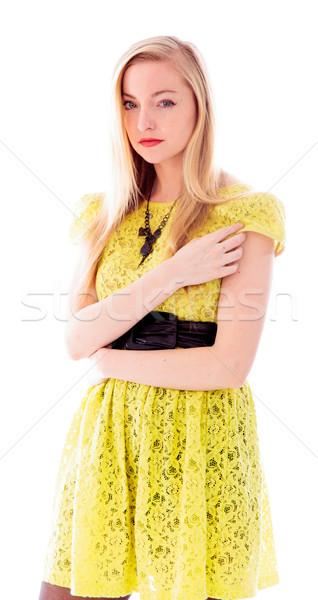 Portré gyönyörű fiatal nő áll ruha citromsárga Stock fotó © bmonteny
