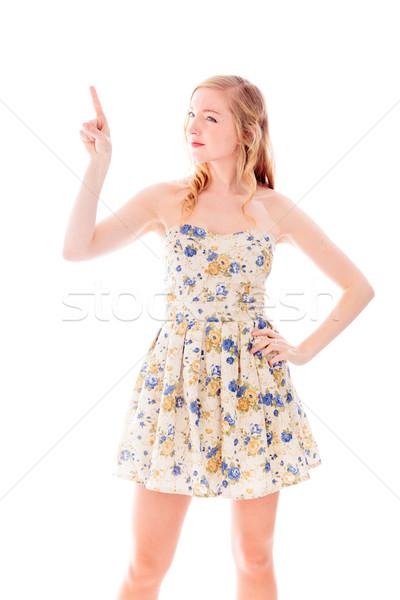 Gyönyörű fiatal nő áll mutat kommunikáció ruha Stock fotó © bmonteny