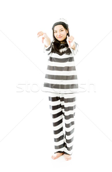 Smiling young Asian woman pointing towards camera from both hands in prisoners uniform Stock photo © bmonteny