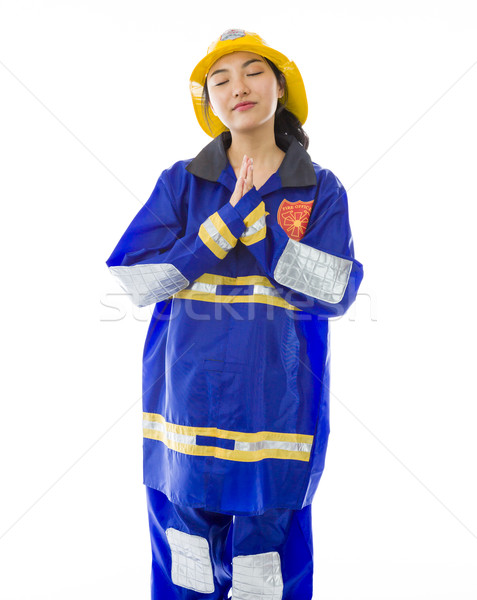 Lady firefighter praying with her hands clasped Stock photo © bmonteny