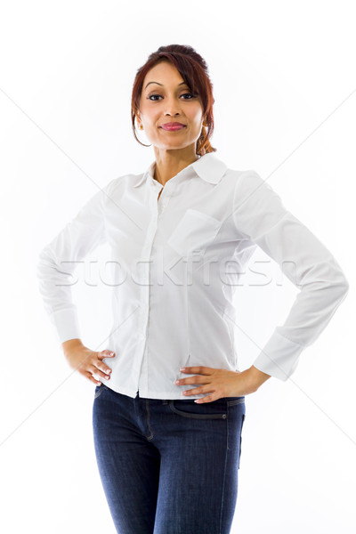 Confident Indian young woman standing with hands on hip Stock photo © bmonteny