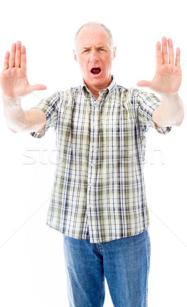 Idős férfi tömés kézmozdulat kommunikáció póló Stock fotó © bmonteny