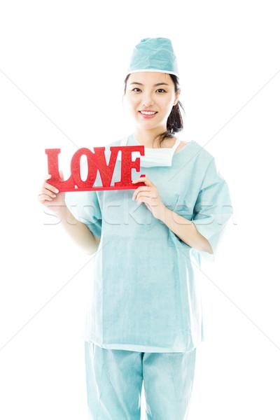 Asian femminile chirurgo rosso amore Foto d'archivio © bmonteny
