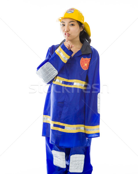 Lady firefighter with finger on lips Stock photo © bmonteny