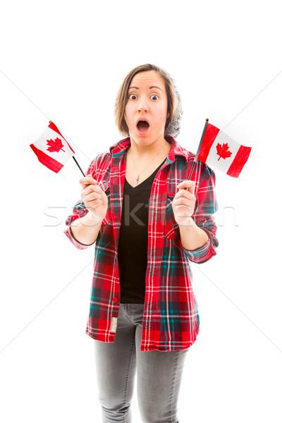 Fiatal nő néz megrémült tart Kanada zászló Stock fotó © bmonteny