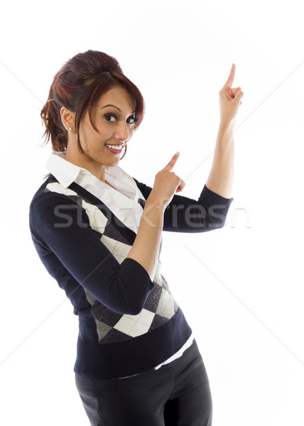 Indian businesswoman pointing and smiling Stock photo © bmonteny