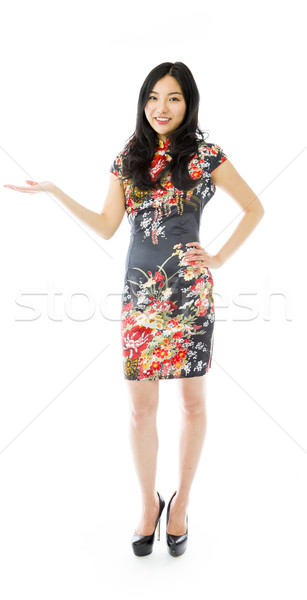 Asian happy young woman presenting isolated on white background Stock photo © bmonteny