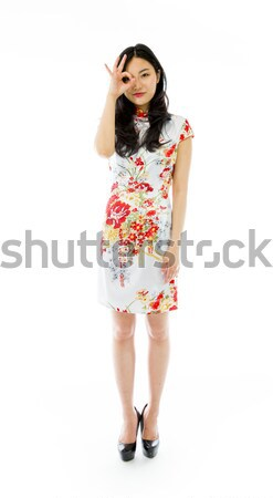 Disappointed Asian young woman holding red 'LOVE' text Stock photo © bmonteny