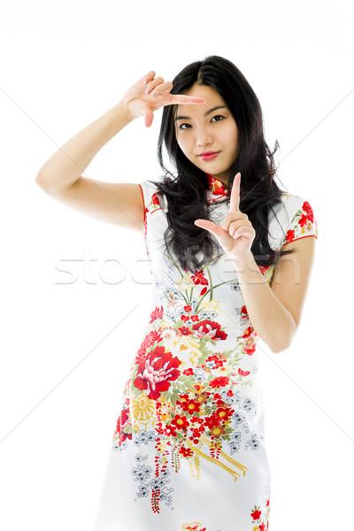 ázsiai fiatal nő néz ujj keret jókedv Stock fotó © bmonteny