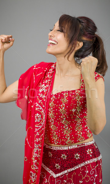 Young Indian woman celebrating success Stock photo © bmonteny
