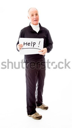 Senior man standing with arms akimbo and smiling Stock photo © bmonteny