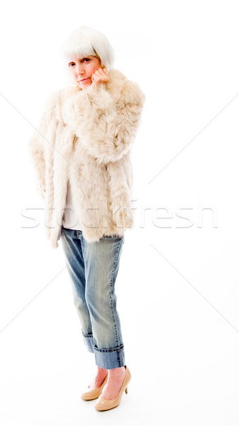 Senior woman standing with her hand on chin Stock photo © bmonteny