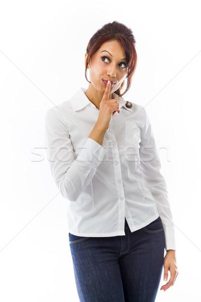 Indiai fiatal nő ujj ajkak felfelé néz felnőtt Stock fotó © bmonteny