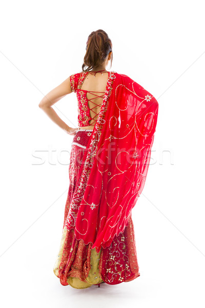 Rear view of a young Indian woman standing with her arms akimbo Stock photo © bmonteny