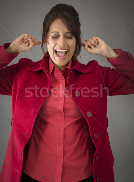 Stock photo: Indian young woman shouting in frustration