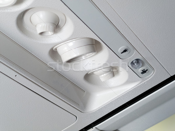 Air conditioners and lamp in an airplane Stock photo © bmonteny