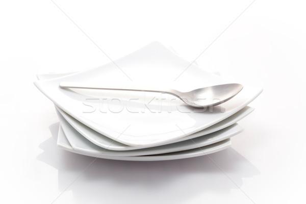Boglya tér tányérok kanál izolált fehér Stock fotó © bmonteny
