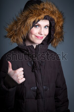 Young woman thinking with her finger on chin Stock photo © bmonteny