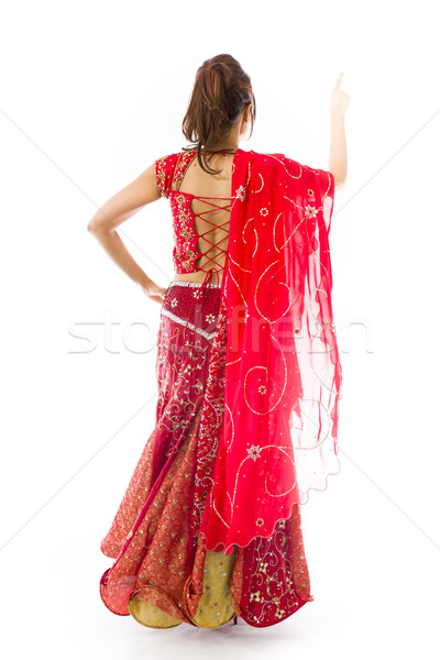 Young Indian woman pretending to work on touch screen Stock photo © bmonteny