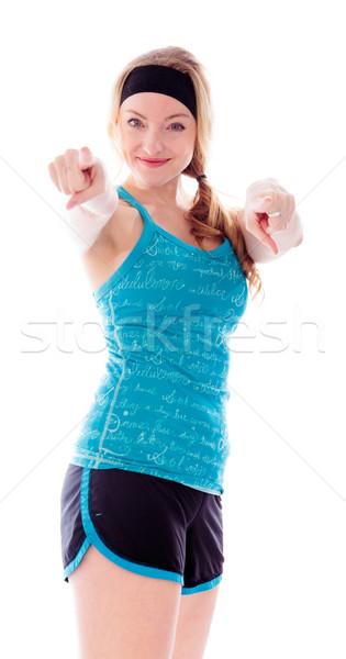 Mulher jovem indicação câmera tanto mãos azul Foto stock © bmonteny