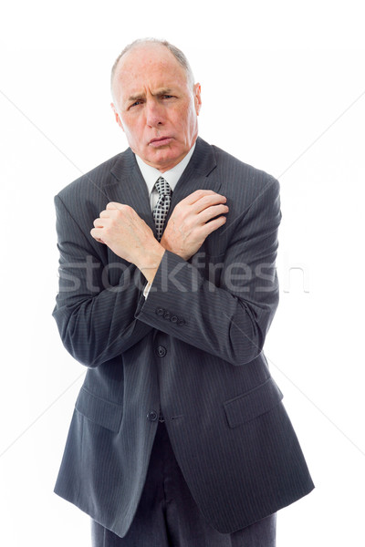 Businessman shivering in the cold isolated on white background Stock photo © bmonteny