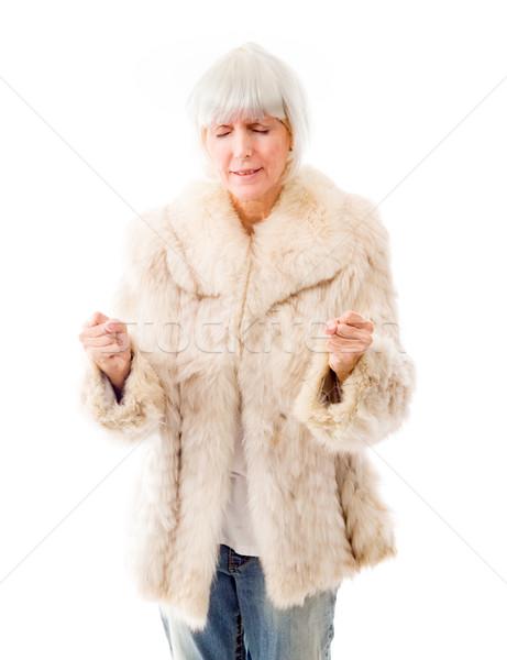 Senior mulher punho branco em pé Foto stock © bmonteny
