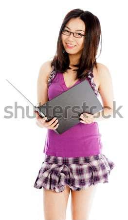 Młodych asian kobieta sms telefonu komórkowego komunikacji Zdjęcia stock © bmonteny