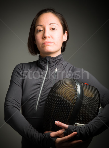 Portrait of a female fencer wearing fencing uniform and holding Stock photo © bmonteny