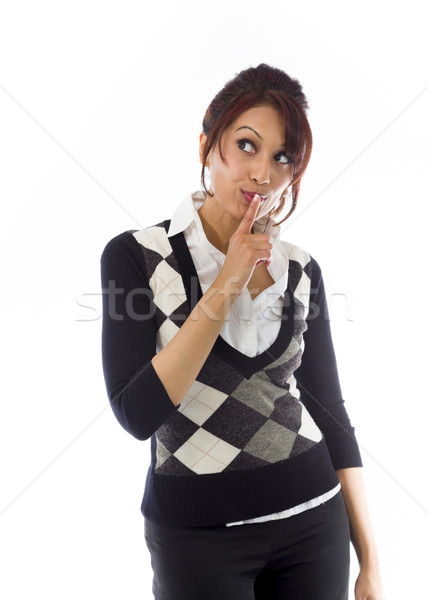 Indian businesswoman with finger on lips Stock photo © bmonteny