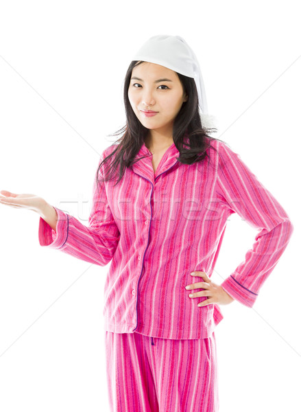 Young Asian woman showing product with open hand palm Stock photo © bmonteny
