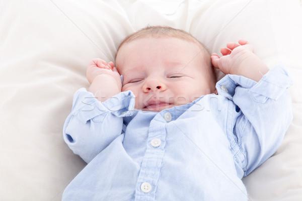 ребенка мальчика спальный кровать улыбаясь счастье Сток-фото © bmonteny