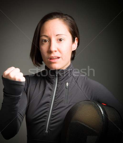 Female fencer punching the air Stock photo © bmonteny