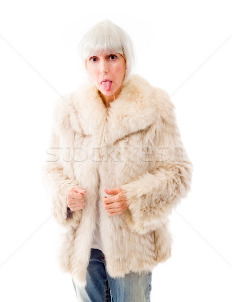 Senior woman sticking out her tongue Stock photo © bmonteny