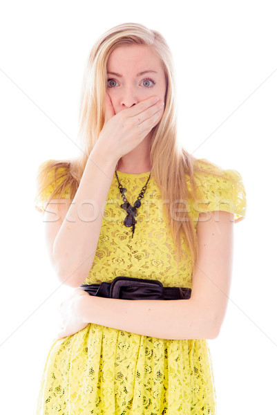 Stock photo: Young woman with hand over her mouth