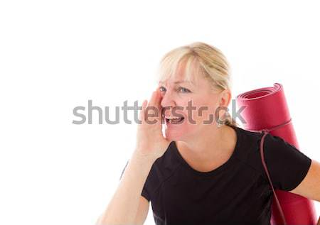 Young woman carrying exercising mat using fingers as glasses Stock photo © bmonteny