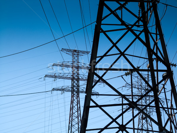 Low angle view of electricity pylons Stock photo © bmonteny