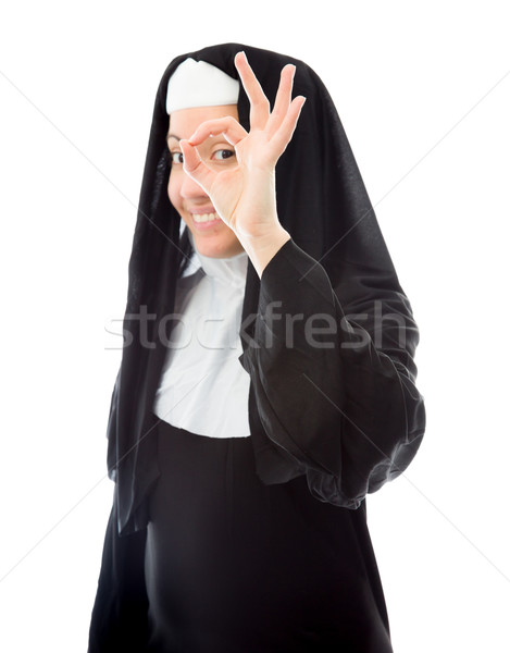 Young nun showing ok sign and smiling Stock photo © bmonteny