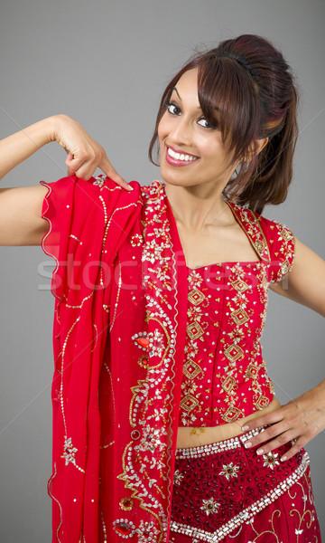 Jóvenes indio mujer senalando adulto estudio Foto stock © bmonteny