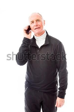 Senior homem falante telefone móvel tecnologia preto Foto stock © bmonteny