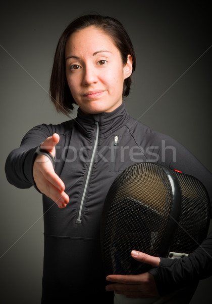Stock photo: Female fencer offering hand for handshake