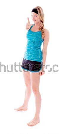 Young woman presenting something and smiling Stock photo © bmonteny