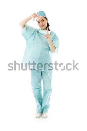 Asiático feminino cirurgião indicação isolado branco Foto stock © bmonteny